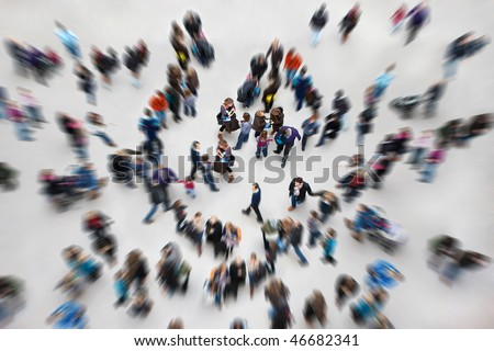 Crowds of people in an urban setting. - stock photo