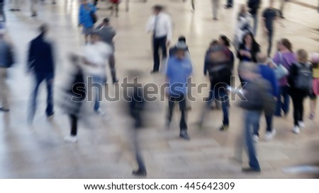 crowds of people walking on crowded public street. anonymous pedestrians commuting in the city. society population growth background