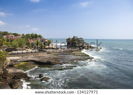crowds of tourists around the tanah lot sea temple in bali indonesia - stock photo