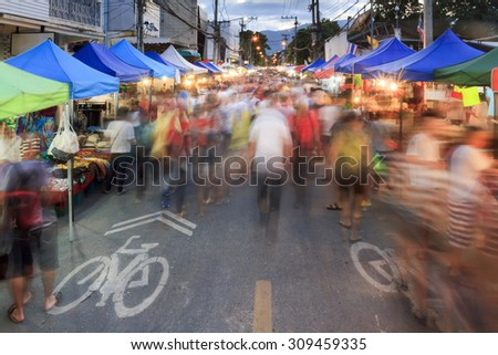Crowds tourist at chiang mai sunday walking street market  - stock photo