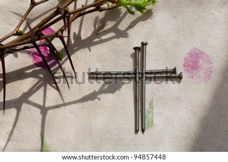 Crown of Thorns and crucifix on   paper background - stock photo
