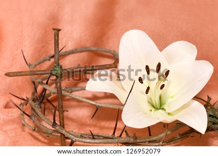 Crown of Thorns, crucifix and Easter white Lily on  Beige background - stock photo