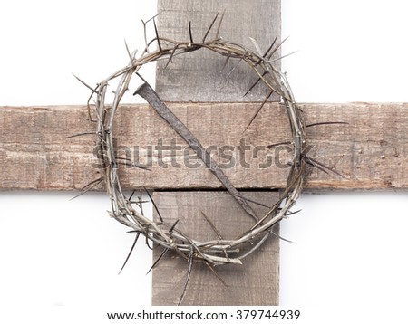 Crown of thorns of Jesus Christ and a nail on the Holy Cross - stock photo