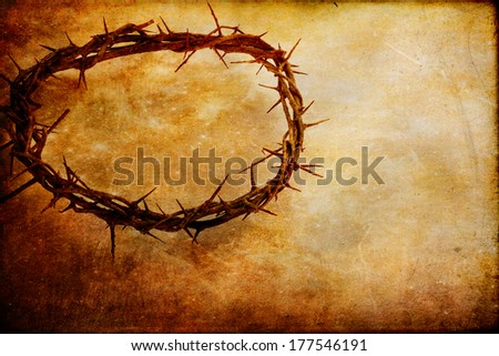 Crown of thorns over textured background with copy space. - stock photo