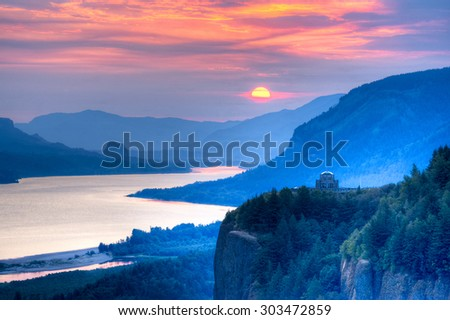 Crown Point and Vista House with rising sun over Columbia River Gorge. - stock photo
