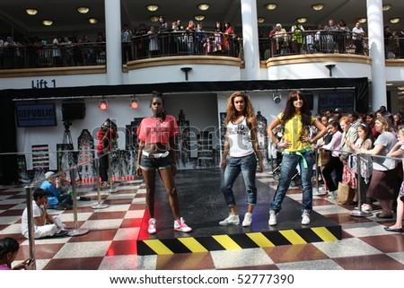 CROYDON, LONDON - APRIL 24 : Models in Fashion Fusion Urban Fashion Show on April 24, 2010 in Whitgift Shopping Centre, Croydon, England. - stock photo