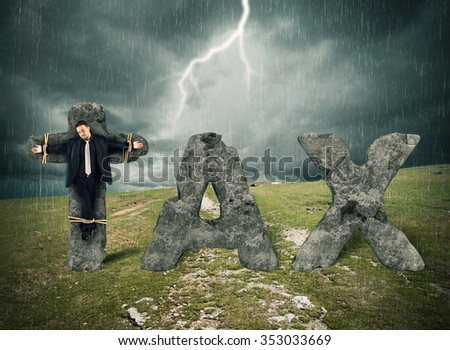 Crucified man on the stone during storm - stock photo