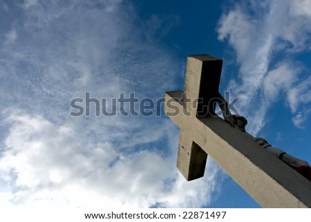 crucifix clouded background.