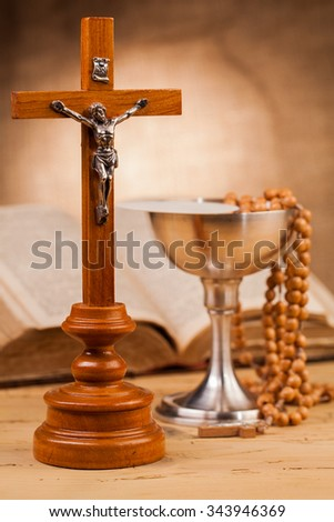 crucifix composition on wooden table - stock photo