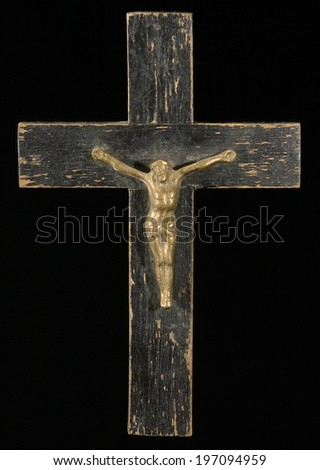 Crucifix with figure of Jesus on black background, vertical - stock photo