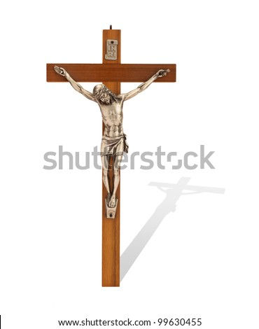 Crucifix with figure of Jesus on white background, vertical with shadow - stock photo