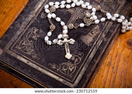 crucifix with jesus on black ancient bible,  - stock photo