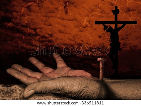 Crucifixion of christ -The hand of Jesus -Jesus Christ is nailed to the Cross - stock photo