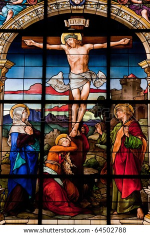 Crucifixion of Jesus, stained glass in the German Church (St. Gertrude's church) in Gamla Stan in Stockholm. - stock photo