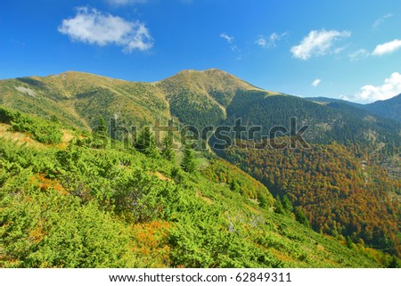 Crude green mountain scenery with ridges - stock photo