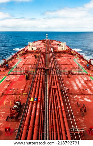 Crude oil carrier with pipeline in open sea - stock photo - stock photo