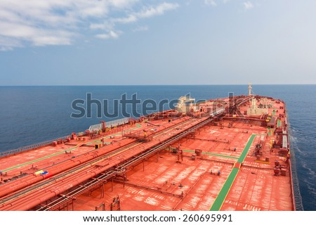 Crude oil carriers red deck with pipeline. Unusual perspective - stock photo. - stock photo