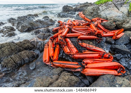 Crude oil on the beach stone and leave boom for protection on oil spill accident on Ao Prao Beach at Samet island on July 31,2013 in Rayong,Thailand - stock photo