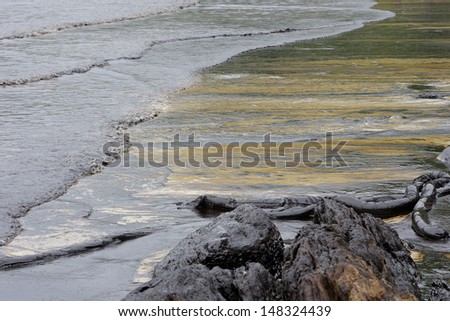 crude oil spill on the beach - stock photo