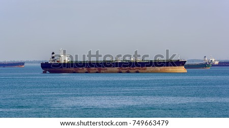 Crude oil tanker anchored in the outer anchorage in anticipation of loading.