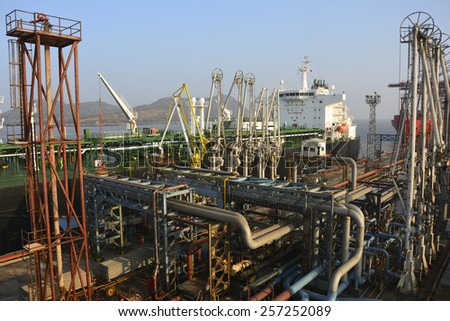 crude oil tanker is loading crude oil terminal in port - stock photo