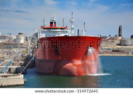 crude oil tanker is loading in port - stock photo