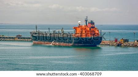 Crude oil tanker pumping ballast water in Lagos, Nigeria, Africa - stock photo