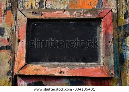 crude weathered frame with peeling paint - stock photo