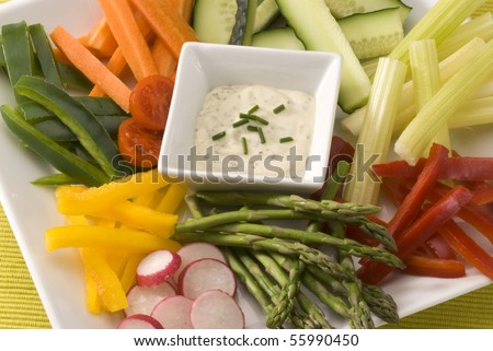 Crudites salad. Assorted vegetables sticks and dip. Selective focus. - stock photo