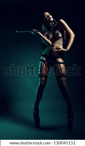cruel bdsm woman with whip - stock photo