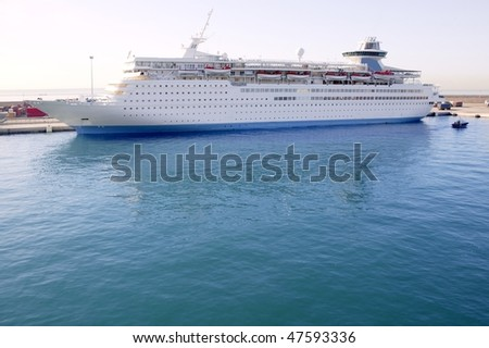 Cruise boat moored on Balearic islands harbor blue water
