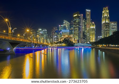 Cruise boats colouring Singapore river at sunset - stock photo