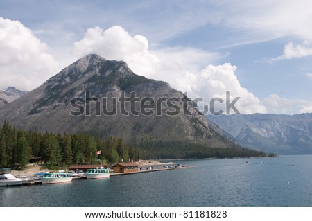 Cruise boats floating at dock at Lake Minnewanka