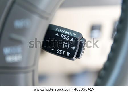 Cruise control buttons on modern car and speed limitation - stock photo