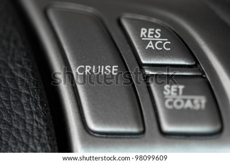 Cruise control on steering wheel - stock photo