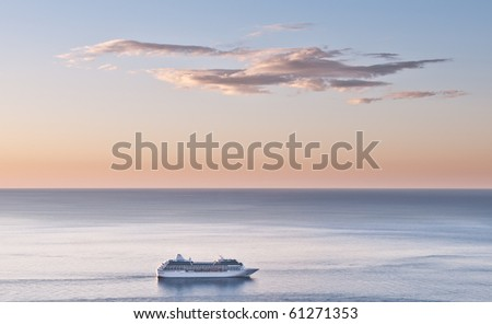 Cruise liner and dawn sky scape (landscape)) - stock photo