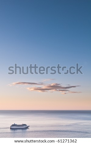 Cruise liner and dawn sky scape (portrait) - stock photo