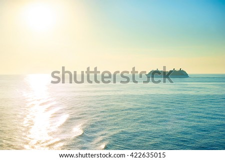 Cruise liner at sunset. Sun in the sky