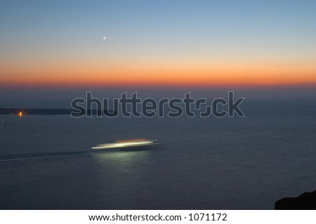 Cruise liner at the sunset and moonrise 2 - stock photo