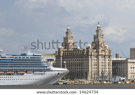 Cruise liner berthed in Liverpool UK with the famous skyline including the Liverbirds in the background - stock photo