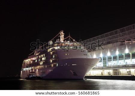 Cruise liner in Hong Kong at night - stock photo