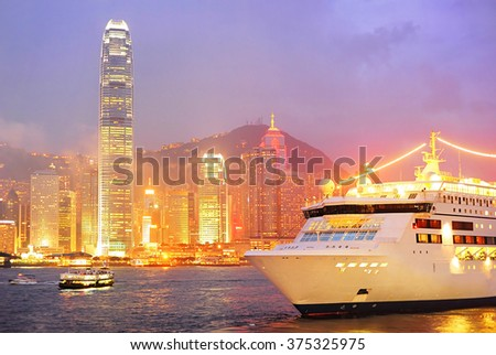 Cruise Liner in Hong Kong at night - stock photo