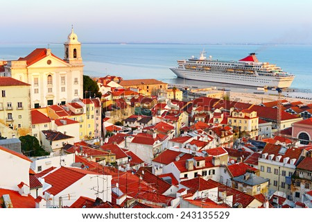 Cruise liner in Lisbon harbor at sunset. Portugal - stock photo