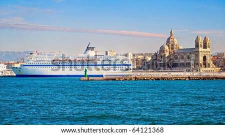 Cruise liner in the port of Marseilles, Provence, France. Famous Marseille Cathedral la Major - Cathedrale Sainte-Marie-Majeure is in background. - stock photo