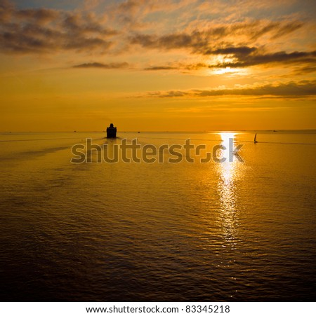 cruise liner in the sea at sunset - stock photo