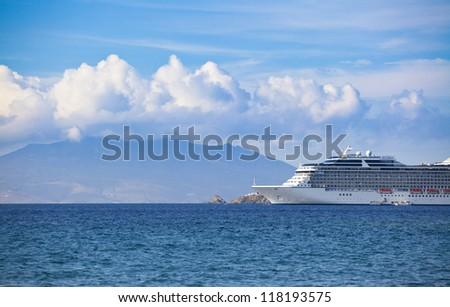 Cruise liner near greek island - Mykonos - stock photo
