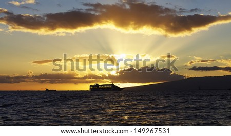 Cruise ship against sunset on Ocean in Hawaii - stock photo