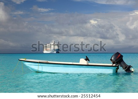 Cruise ship and fishing boat in tropical beach scene
