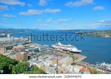 Cruise ship and lower town old buildings with blue sky in Quebec City. - stock photo