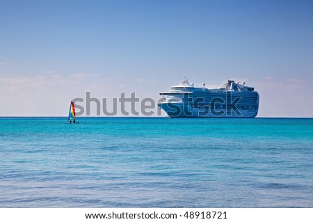 Cruise Ship and Sailboat in Caribbean - stock photo